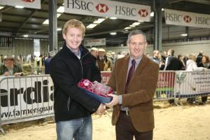 Richard Jones (left) receiving the personality in sheep shearing award from David John, Sales Manager, Lister Shearing Equipment Ltd.