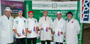 The four butchers in the Wales heat (from left) Peter Rushforth, Matthew Edwards, Daniel Allen-Raftery and Dafydd Jenkings with judges Viv Harvey (right) and Chris Jones (left) Butchry worldskills