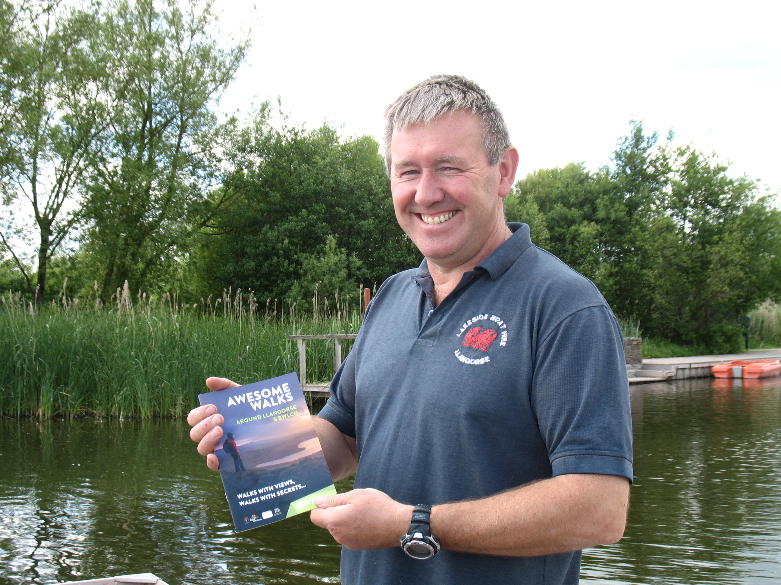 Garnet Davies from Lakeside Boat Hire in Llangors pictured with the new booklet
